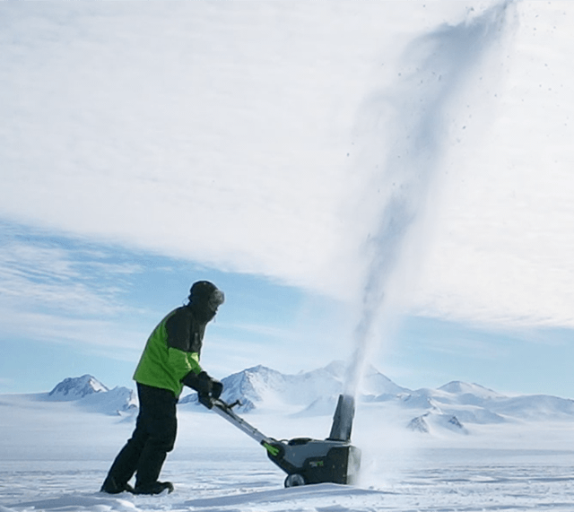 A man testing an EGO Snow Blower in a vast snowy environment.