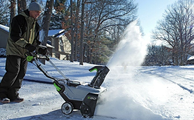 Man using the Snow Blower with Peak Power™ to clear a driveway