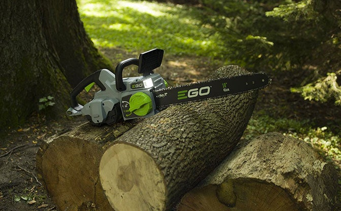 "Power+ 18"" Chain Saw on logs"