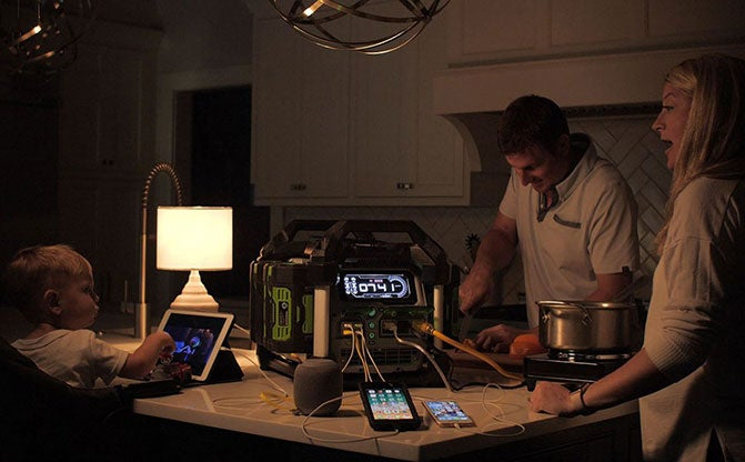 People using Nexus Portable Power Station indoors to power devices and an electric hot plate