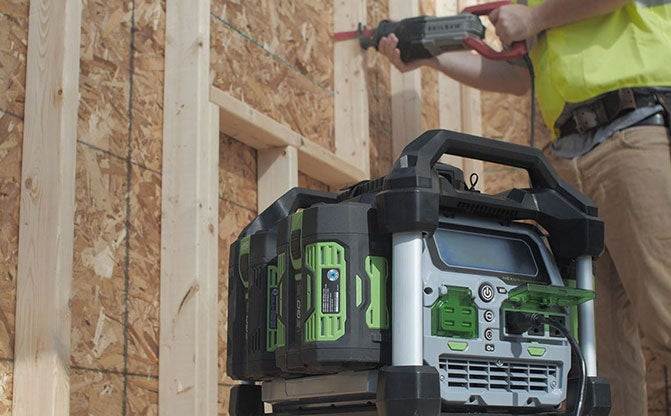 Man on a jobsite powering a saw with the Nexus Portable Power Station