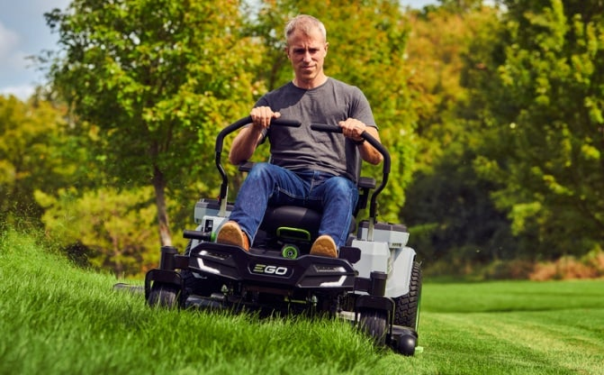 """The 42"""" Z6 Zero Turn Riding Mower in use on a large lawn"""