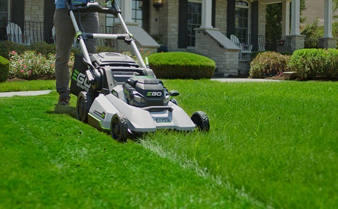 """Front view of the POWER+ 21"""" Select Cut™ Mower cutting a lawn"""