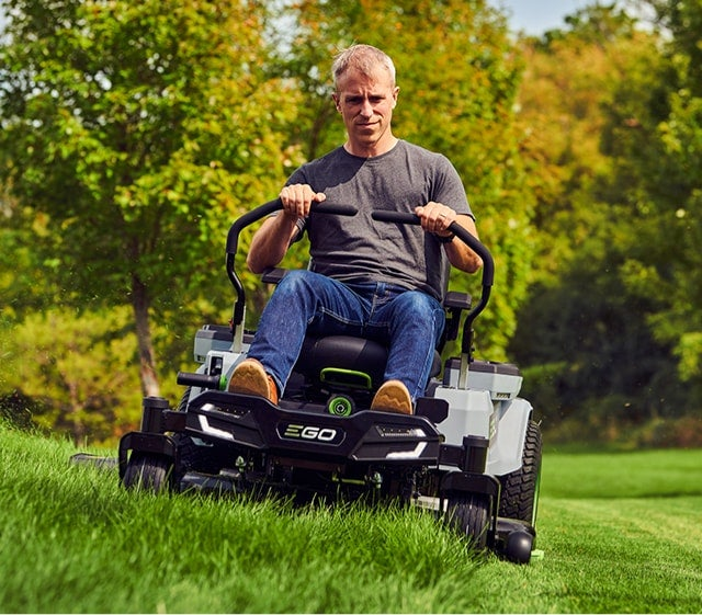 Front view of a man mowing with the Z6 Zero Turn Riding Mower