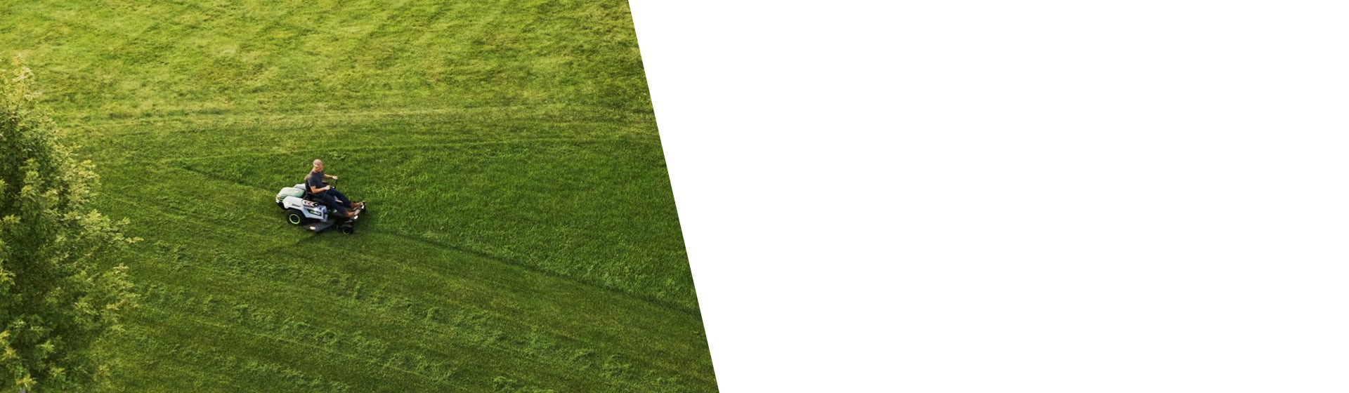 Overhead shot of a man mowing a very large lawn with the Z6 Zero Turn Riding Mower